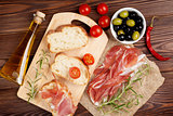 Bruschetta ingredients - prosciutto, olives, tomatoes