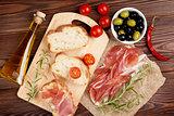 Bruschetta ingredients - prosciutto, olives, tomatoes