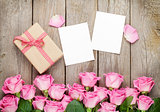 Photo frames, gift box and pink roses