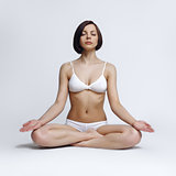 Young woman in yoga pose on white background