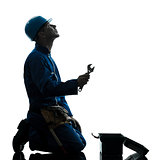 repair man worker despair praying silhouette