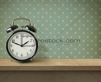 Alarm clock on table or shelf background