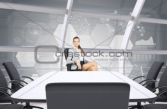 Businesslady sitting half-turned at table