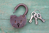 Old rusty padlock and key