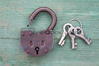Old rusty padlock and key