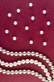 Silver and White pearls necklace on dark red