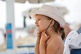 Child in a white hat