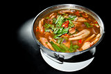 Spicy soup Chicken Foot in hot bowl and black background