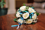 wedding bouquet on the wooden table