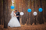 happy bride and groom walking in the forest