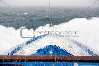 Cruise Ship bow hitting arctic waters near Spitsbergen, Svalbard, Norway.