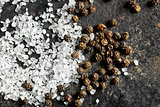 salt crystals and black peppercorns