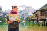 Woman at Lake Bries holding an open map and smiling