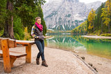 Woman hiker resting at picnic table on Lake Bries