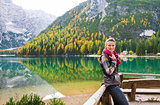 Smiling woman hiker at Lake Bries holding scarf
