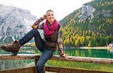 Smiling woman hiker posing at Lake Bries with autumn colours