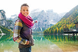Smiling woman hiker at Lake Bries pointing at scenery
