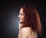 Profile view of a beauty with curly red hair