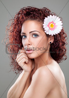 Beautiful woman with curly red hair