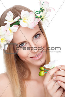 Beautiful woman with a crown of flowers