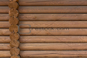 timbered wooden wall made from logs as background