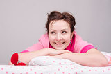 girl is happy with ring, lying in bed
