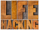 life hacking word abstract in wood type