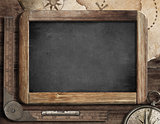Vintage blackboard with treasure map, old compass and ruler. Adventure and discovery concept.