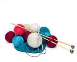 colorful balls of wool with needles