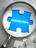Consulting - Puzzle with Missing Piece through Loupe.
