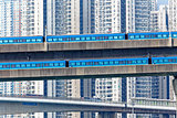high speed train on bridge in hong kong downtown city