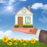House on businessmans hand