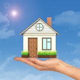 House on businesswomans hand