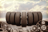 Wheels on blue sky abstract background