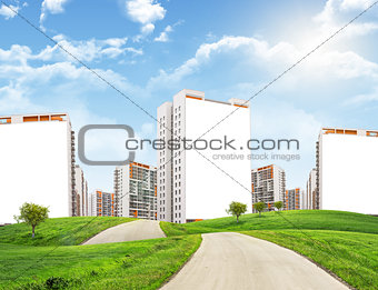Cityscape under blue sky with road