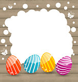 Holiday card with Easter colorful eggs on wooden background