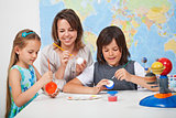 Kids making a scale model of the solar system in science class-