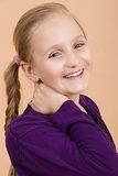 Fashion smiley european little girl posing