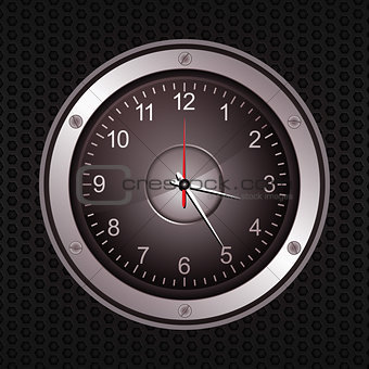 Clock in a speaker on black metallic background