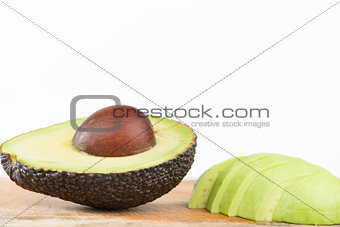 Closed up half of Avocado fruit on white