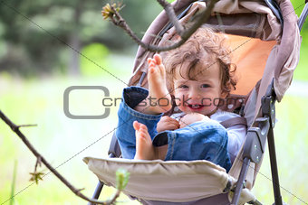 Baby boy in stroller outdoor