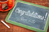 congratulations on blackboard with a cup of tea