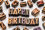 happy birthday in wood type blocks