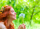 Cheerful female with dandelions