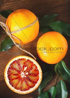 Blood orange fruit close up on wooden table