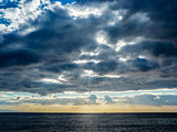 Sky with clouds over black sea