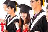 beautiful asian female college graduate at graduation with class