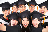 closeup Group of graduation Friends Smile for Camera