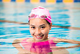 young woman close up portrait in swimming pool