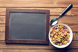chalkboard and colorful cereal rings in spoon